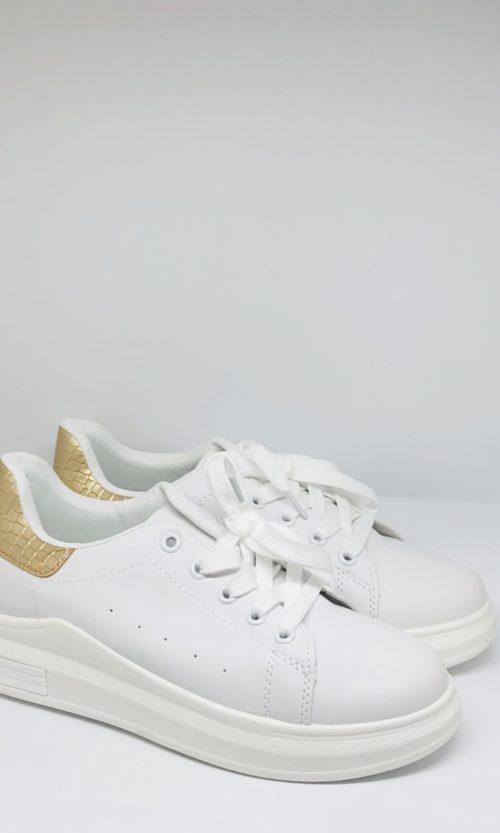 Zapatilla blanca con talón dorado